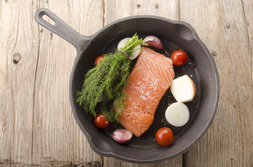 salmon fillet in a cast iron pan