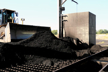 Front End Loader Pushing Coal Into Pulverizer