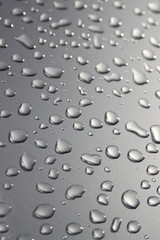 Raindrops on silver surface