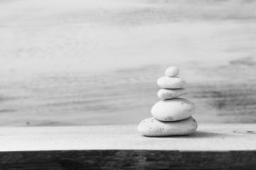 Pile zen stones wooden board