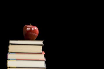 Books Apple and Teacher's Blackboard