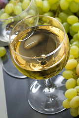 glass of white wine and grapes, close-up