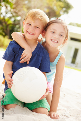 canvas print picture Two Children Playing Game Of Volleyball In Garden