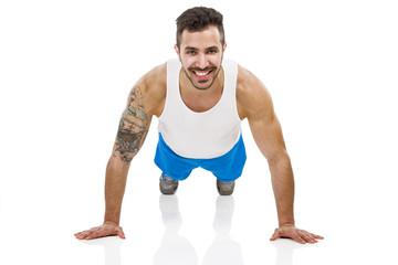 Athletic man making pushups
