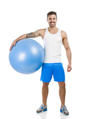 Athletic man with a pillates ball