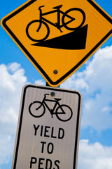 bicycle signs downhill and yield to pedestrians