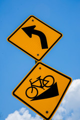 bicycle signs downhill and left turn ahead