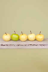 Row of Apples on Rustic Wood Bench
