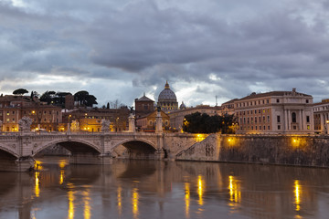 Sant 'Angelo Bridge and St. Peter's Basilica at dusk, Rome.