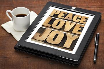 peace, love and joy on a tablet