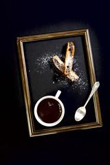 Coffee, biscotti and a teaspoon.