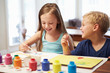 Two Children Painting Picture At Home - 70862963