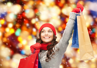 asian woman in winter clothes with shopping bags