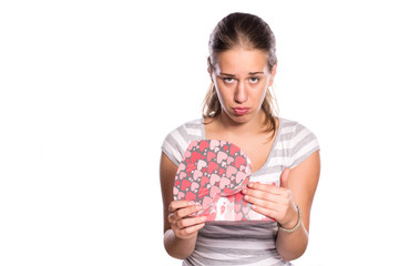 Cute young girl not happy with birthday present