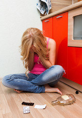 Drunken woman at the kitchen