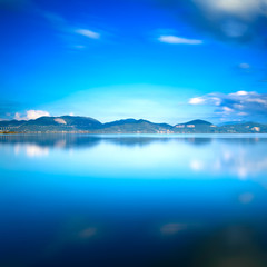 Blue lake sunset and sky reflection on water. Versilia Tuscany,