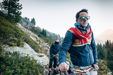 Young man riding a mountain bike downhill