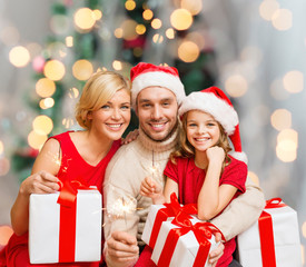 happy family in santa helper hats with gift boxes