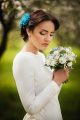 Portrait of a bride closeup with beautiful bouquet