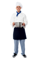 Male chef holding a steel saucepan