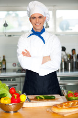 Male chef chopping vegetables in table