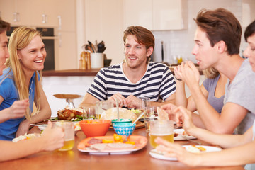 Group Of Young Friends Enjoying Meal At Home