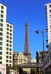 View on Eiffel Tower on urban street in Paris, France