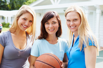 Portrait Of Young Women Playing Basketball Match