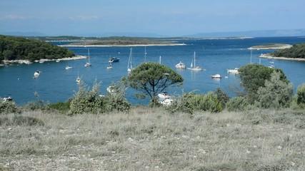 Sailboats in a bay in Kamenjak National Park, Istria, Croatia