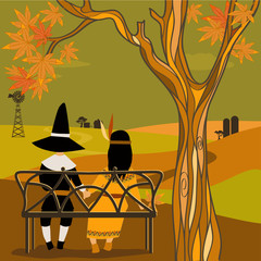 Kids in Thanksgiving costumes sitting under a tree