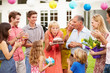 Multi Generation Family Celebrating Birthday In Garden - 70867772