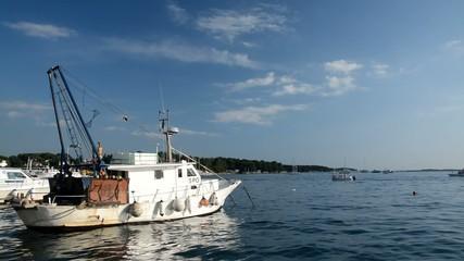 Fishing boat in the port in Porec, Istria, Croatia