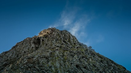 Steaming volcano cone of Pico mountain in the Azores