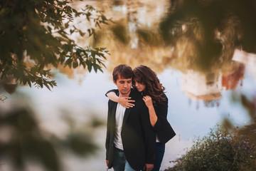 Loving girl tenderly embraces her boyfriend
