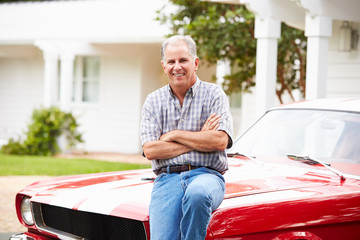 Portrait Of Retired Senior Man With Restored Car