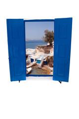 Open traditional Greek blue window on Milos island, Greece