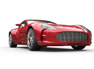 Red metallic car on white background