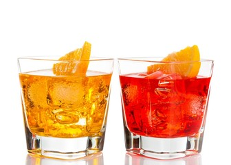 red and yellow cocktail with orange slice on top isolated