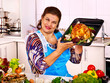 canvas print picture - Mature woman preparing chicken at kitchen.