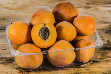 Group of apricots on a rustic table