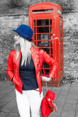 Trendy young blond woman standing waiting