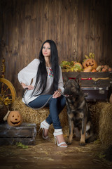 German Shepherd with beautiful witch on Halloween