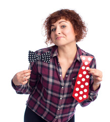 woman chooses a tie and a butterfly