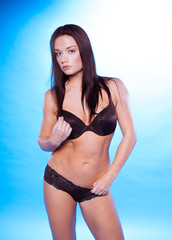 Sexy Young Woman in Black Underwear