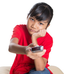 Bored young Asian girl with television remote control device