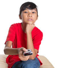 Young Asian girl with television remote control device