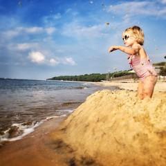 girl in sand castle