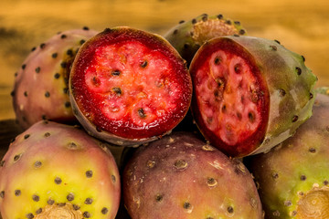 prickly pears on rustic table