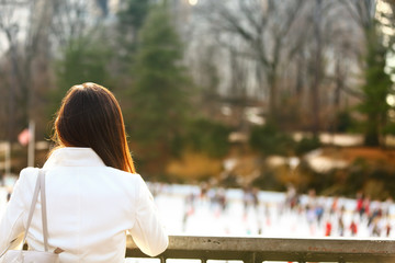 Central park skating rink - woman in New York City