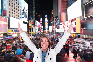 Happy excited woman in New York, Times Square